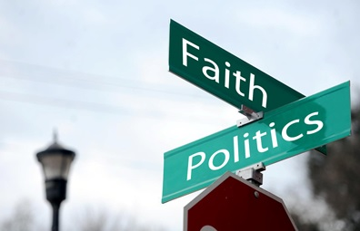 Street signs showing intersection of Faith and Politics.