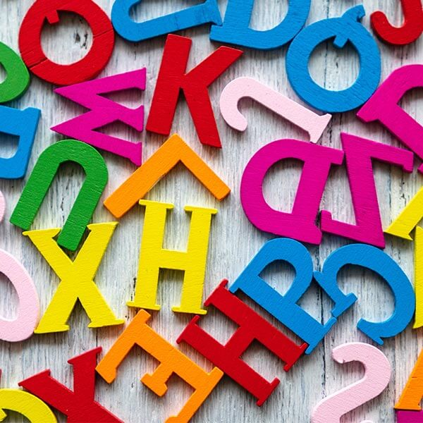Alphabet letters scattered on table
