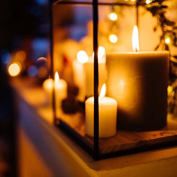 Lit candle to welcome visitors