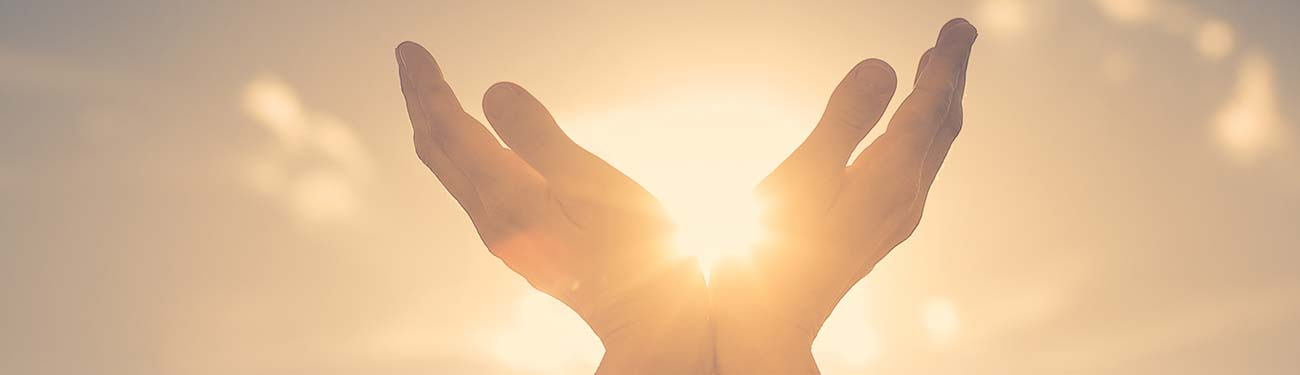 hand reaching out for the sun