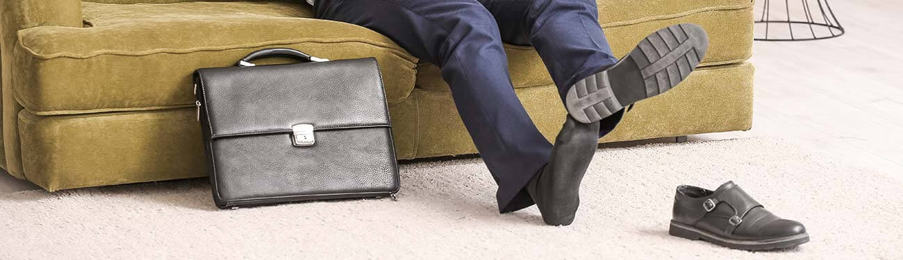 man taking off his shoes at home