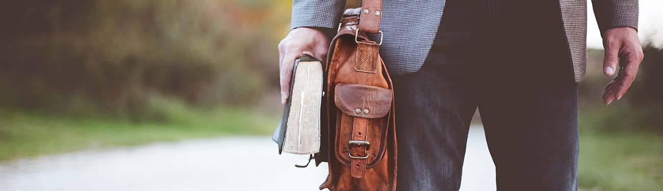 Man holding Bible in his hand