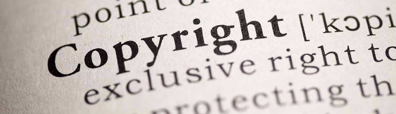 close up of the word copyright in dictionary