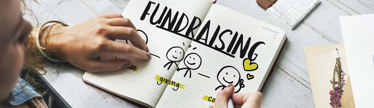 person taking notes on fundraising